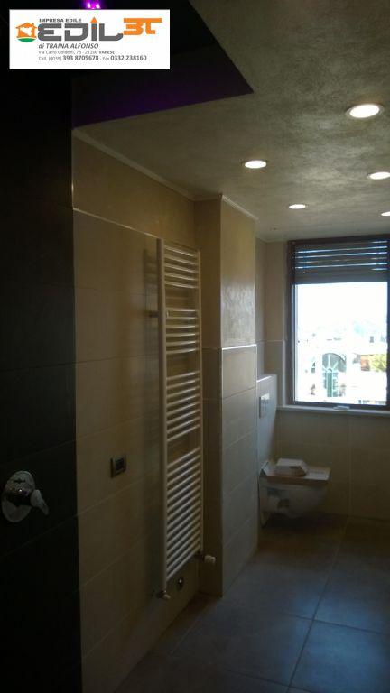Rifacimento bagno con doccia in muratura e abbassamento in ...